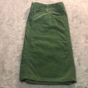 Ann Taylor green mini skirt.